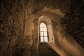 Mysterious ancient window in the dark castle Stock Photography