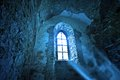 Mysterious ancient window in the dark castle Royalty Free Stock Photo
