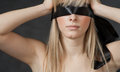 Mysterious beautiful face with ribbon blindfold on eyes this image has attached release Stock Images