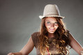 Mysterious enigmatic intriguing woman girl in hat portrait of studio on grey young attractive shining light Stock Photos