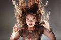 Mysterious enigmatic woman girl with flying hair. Royalty Free Stock Photo