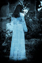 Mysterious ghost of girl in white dress Stock Photo