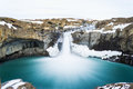 Mysterious huge waterfall among mountain hidden mountains i iceland Royalty Free Stock Photography
