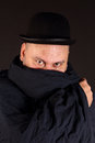 Mysterious man portrait of a with bowler hat Stock Photo