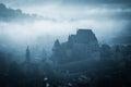 Mysterious misty morning over Biertan village, Transylvania, Romania. Royalty Free Stock Photo