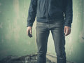 Mysterious person in derelict room Royalty Free Stock Photo