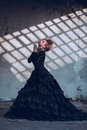 Mysterious woman in black dress dressed gothic posing ruined building Royalty Free Stock Photography