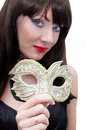 Mysterious woman holding venetian mask Royalty Free Stock Image