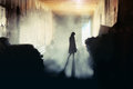 Mysterious woman a lone wonan stands in a misty underground tunnel Royalty Free Stock Images