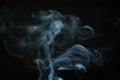 Mystery blue smoke over dark background closeup