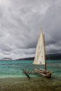 Mystery island old meets new cruise ship and traditional outrigger canoe on inyeug vanuatu Royalty Free Stock Photos