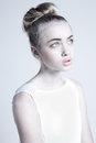 Mystic beautiful female with strange weird hairstyle and pink lips and green eyes Royalty Free Stock Photos