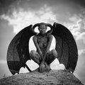 Mystic creature woman in body paint with the wings and horns Royalty Free Stock Images