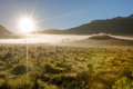Mystic morning fog and surreal landscape with in the mountains on way to the cradle mountain lake st clair national park tasmania Royalty Free Stock Photography