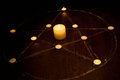 Mystic pentagram with fired candles in darkness, on wooden background
