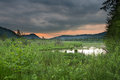 Mystic sky sky at swamp in austria cloudy red sunset and green nature Royalty Free Stock Image