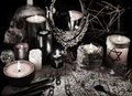 Mystic still life with magic mirror, demon paper and candles in grunge vintage style Royalty Free Stock Photo