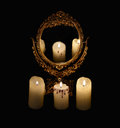 Mystic still life with mirrow and three burning candles Royalty Free Stock Photo