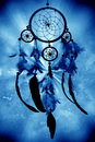 Mystical dreamcather a dreamcatcher on a blue background Stock Photo