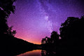 A mystical place the milky way rising above trout lake located off the blue ridge parkway Stock Photography