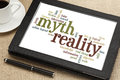 Myth and reality word cloud of words or tags related to on a digital tablet Royalty Free Stock Photo