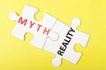 Myth vs reality and words on two pieces of puzzle Royalty Free Stock Image