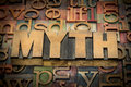 Myth word in wood type against background of letterpress printing blocks Royalty Free Stock Images