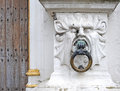 Mythical stone head as a doorknob detail of old court of justice brugse vrije bruges Royalty Free Stock Photo