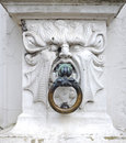 Mythical stone head as a doorknob detail of old court of justice brugse vrije bruges Royalty Free Stock Image