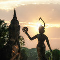 Mythology and religious statues at wat xieng khuan buddha park laos amazing view of sunset vientiane Royalty Free Stock Photos