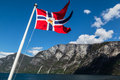 Nærøyfjord norway a norwegian flag and the mountains around in Royalty Free Stock Image