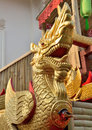 Na ga sculpture of history serpent decorated with golden majestic carved wooden doors festival lanna chiang mai thailand Stock Photos