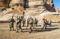 Nabatean soldiers with spears into petra is an editorial image in a sunny day Stock Photos