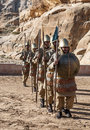 Nabatean soldiers with spears into petra is an editorial image in a sunny day it s a vertical picture Stock Photography