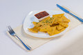 Nacho chips and salsa on plate at place setting Royalty Free Stock Photography