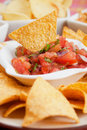 Nachos, corn chips with fresh salsa Stock Photography