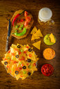 Nachos with dip and beer Royalty Free Stock Photo
