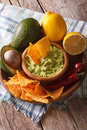 Nachos, guacamole hot sauce and ingredients close-up. vertical Royalty Free Stock Photo