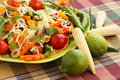 Nachos heap of with vegetables on green plate Stock Images
