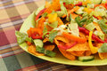 Nachos heap of with vegetables on green plate Royalty Free Stock Photos
