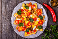 Nachos with melted cheese sauce, jalapeno, chicken and vegetable Royalty Free Stock Photo