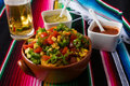 Nachos salad hot sauces and beer Royalty Free Stock Photo