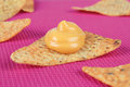 Nachos several tortilla chips with cheese on a tablecloth Stock Photo