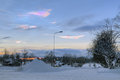 Nacreous clouds over the Stromsund in winter sunset, Sweden Royalty Free Stock Photo