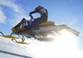 Nadim russia february snoukross vadim vasuhin in jump with springboard on snowmobile during snow cross country race Stock Images