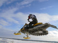 Nadim russia february snoukross vadim vasuhin in jump with springboard on snowmobile during snow cross country race Stock Photo