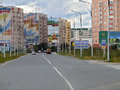 Nadym russia august the city skyline in central road with riding on her car Royalty Free Stock Photos