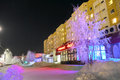 Nadym russia february supermarket in the center of city beautifully illuminated building and trees far north Stock Image