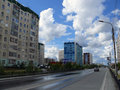 Nadym russia july the city skyline in central road with riding on her car Royalty Free Stock Photos