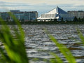 Nadym russia july hotel iceberg foreground to the b background of city in quay on river Royalty Free Stock Photos